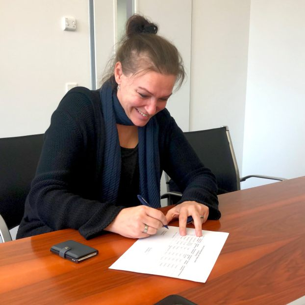 carmen-signing-contract