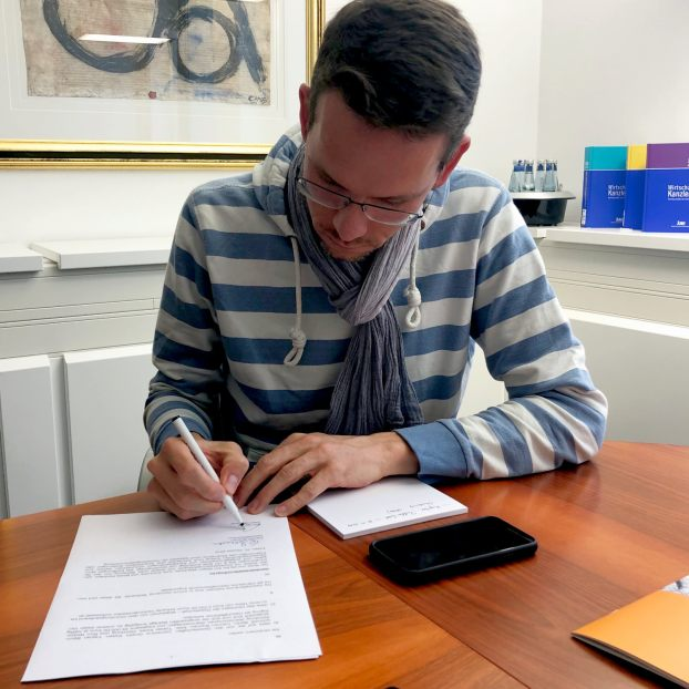rico-signing-contract